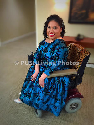 Woman using a power wheelchair at en evening reception