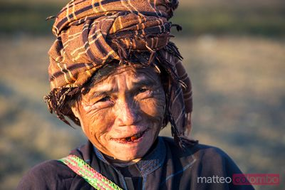 Portrait of old burmese woman in a field, Kalaw, Myanmar