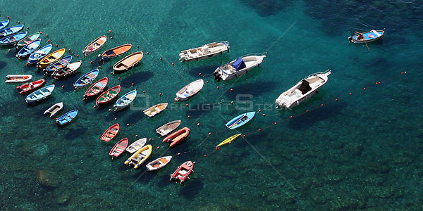 Boats moored in the clear waters of the harbour at Vernazza, Cinque Terre, Italy, 2006.