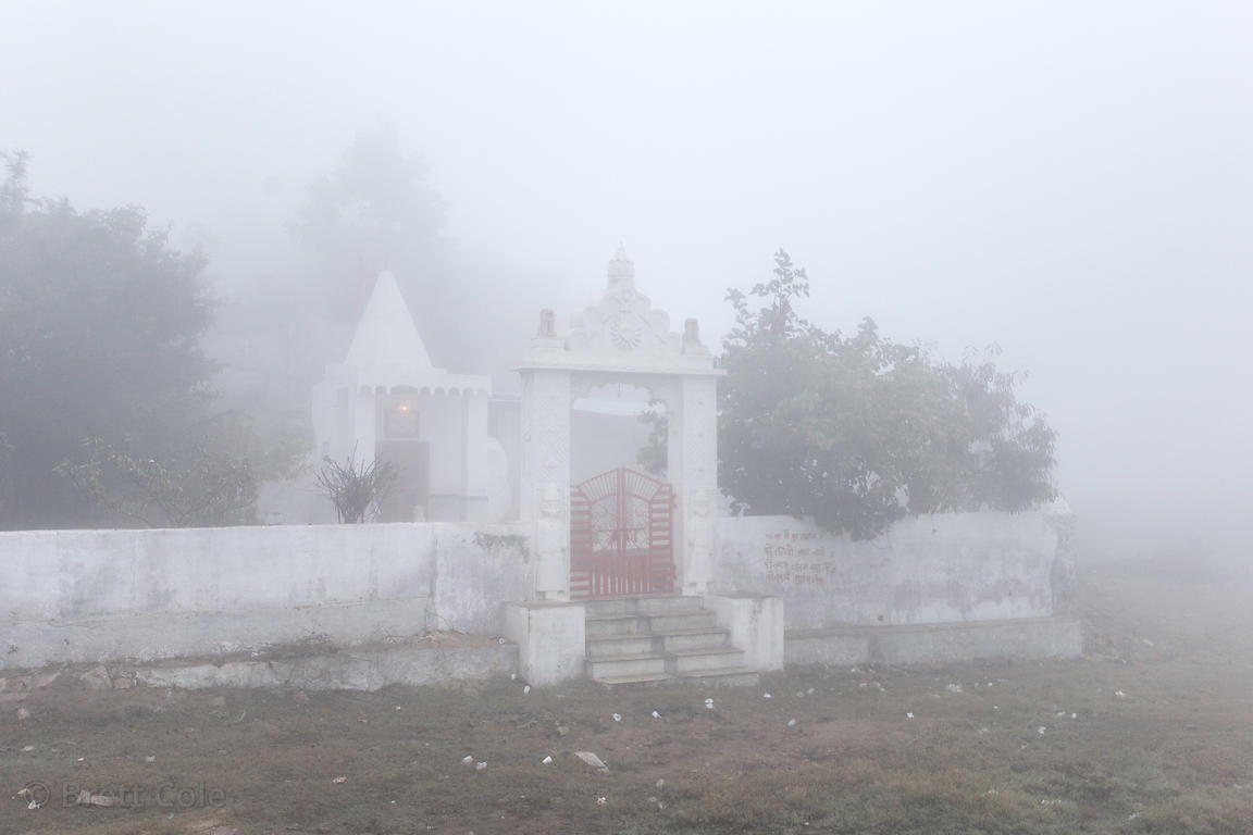 Heavy winter morning fog at the Aloo Baba temple, Ajaypal, Rajasthan, India. Aloo (potato) Baba (holy man) is an old man livi...
