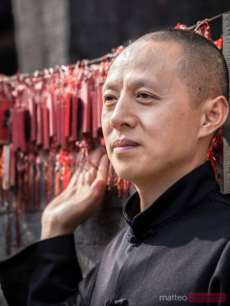 Buddhist monk in a temple in Pingyao, China