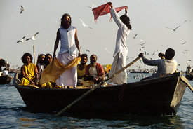 India - Allahabad - Saddhus in a boat at the Kumbh Mela. Ardh Kumbh Mela 1995, Allahbad, India