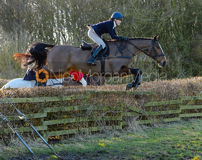 Isobel McEuen jumping a hedge at Town Park Farm - The Cottesmore at Town Park Farm