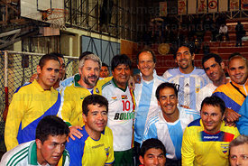 Bolivian president Evo Morales poses with members of the Argentine and Venezuelan embassy teams at a futsal tournament, La Pa...