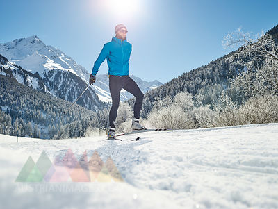 Austria, Tyrol, Luesens, Sellrain, cross-country skier in snow-covered landscape