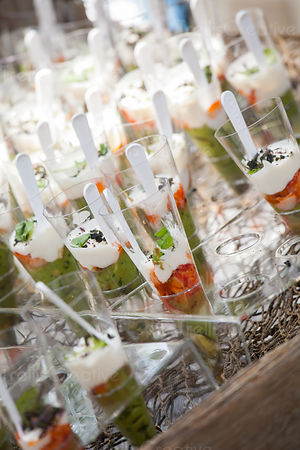 Savory h'oderves served in glasses at an event or a party