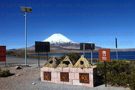 Solar powered street light and recycling bins outside CONAF wardens hut at Lake Chungara , Parinacota volcano in background ,...