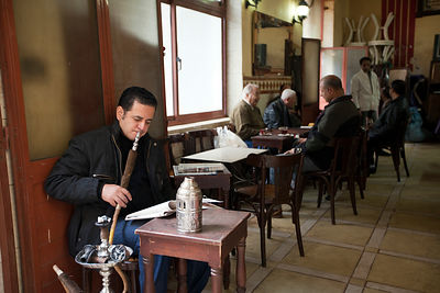 Egypt - Cairo - A man smokes a shish pipe at the Telegraph Cafe, off Halim Square