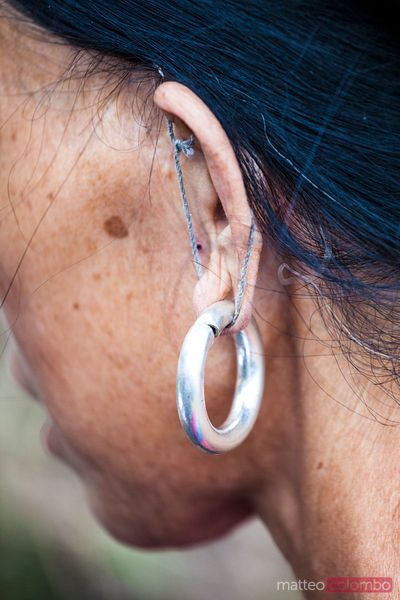 Close up of earring of Yao woman, China