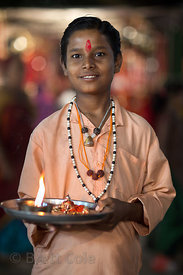 A boy collects donations during Kartik Purnima, Pushkar, Rajasthan, India
