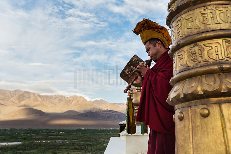 Monk Playing the Call to Prayer on a Conch Horn