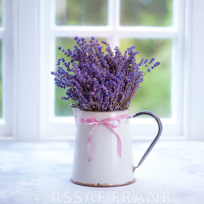 Bunch of lavender in antique jug by the window - Indoors
