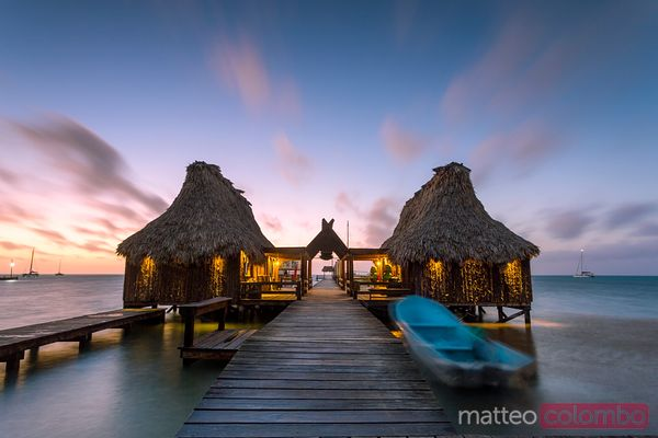 Water bungalow of tourist resort at sunset, San Pedro, Belize