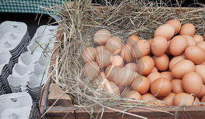 Organic eggs in wooden crate