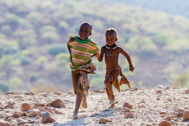 Himba Children Running Down a Road