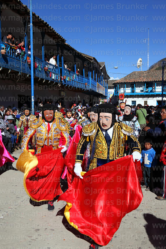 Dancers dressed as Spanish matadors at Virgen del Carmen festival , Paucartambo , Peru