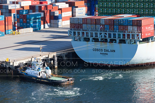 Tugboat Assisting Container Ship