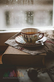 Cup of Chinese green jasmin tea on book