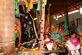 Machetero dancer praying to figure of San Ignacio in Jesuit Mission church after mass, San Ignacio de Moxos, Bolivia