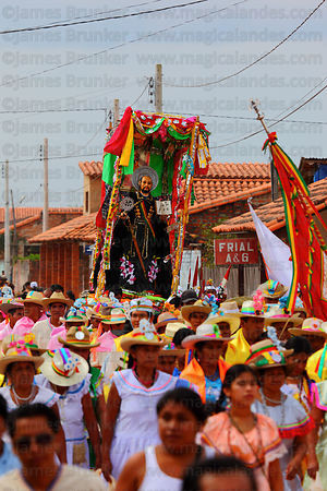 Abadesas accompany figure of San Ignacio during main procession of festival, San Ignacio de Moxos, Bolivia