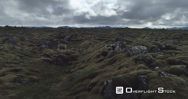 Flying Low Over Thick Moss on Rugged Volcanic Rocks Iceland Dark Sky Drone Footage