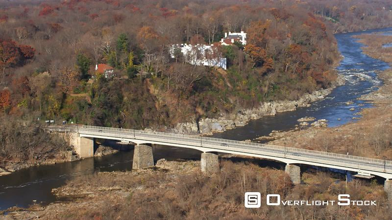 Over the Chain Bridge on the Potomac River in autumn, houses on the Virginia shore at left. Shot in November