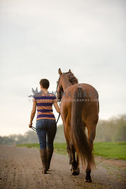 horse and woman walking away