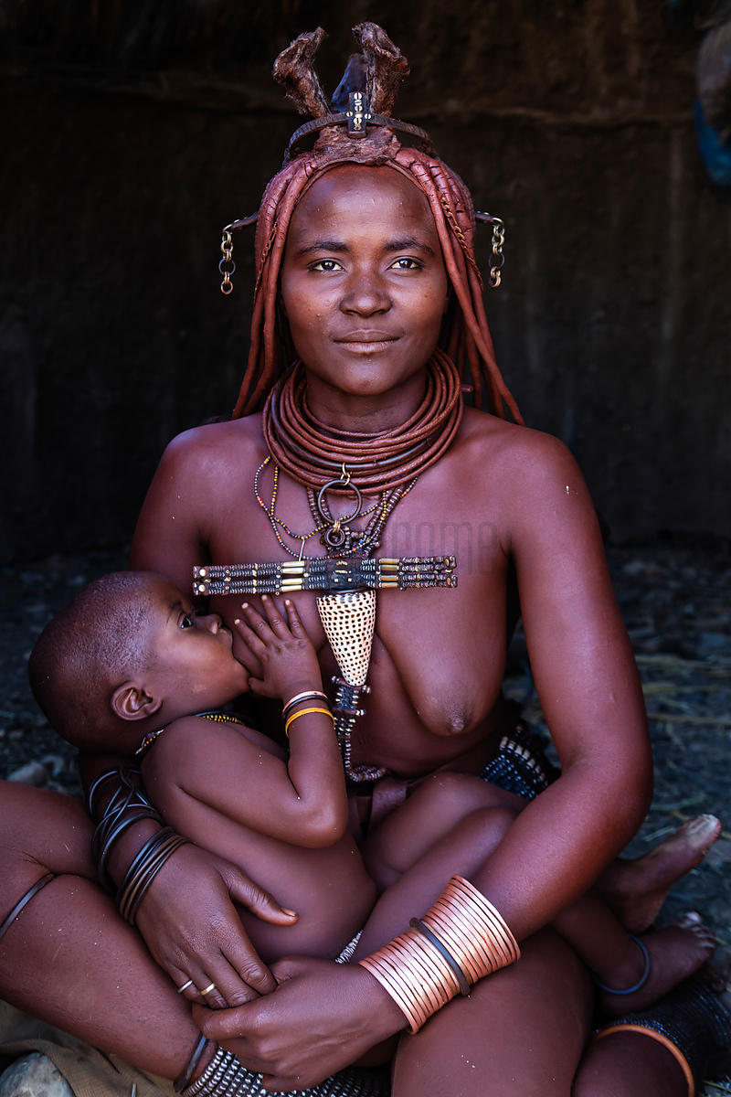 Himba Woman Breast Feeding Baby