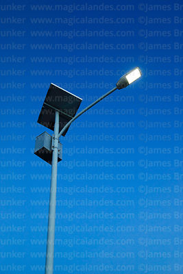 Solar powered street light before dawn
