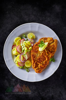 Dish of escalope and fried potatoes