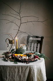 Holiday tablescape with chocolate bark, dried fruit, fruit, and dip