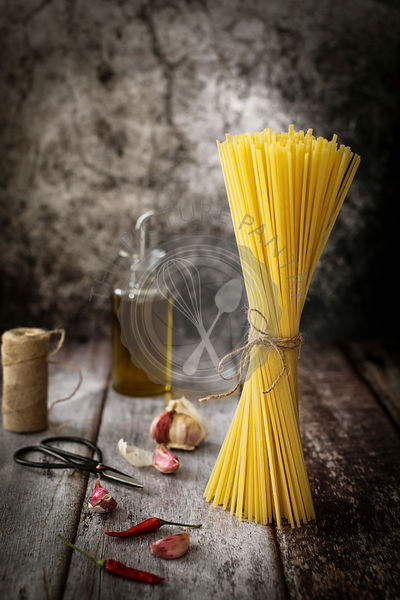Tied dried spaghetti pasta on a rustic background