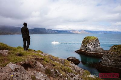 Boy looking at coastline, Snaefellsnes peninsula, Iceland