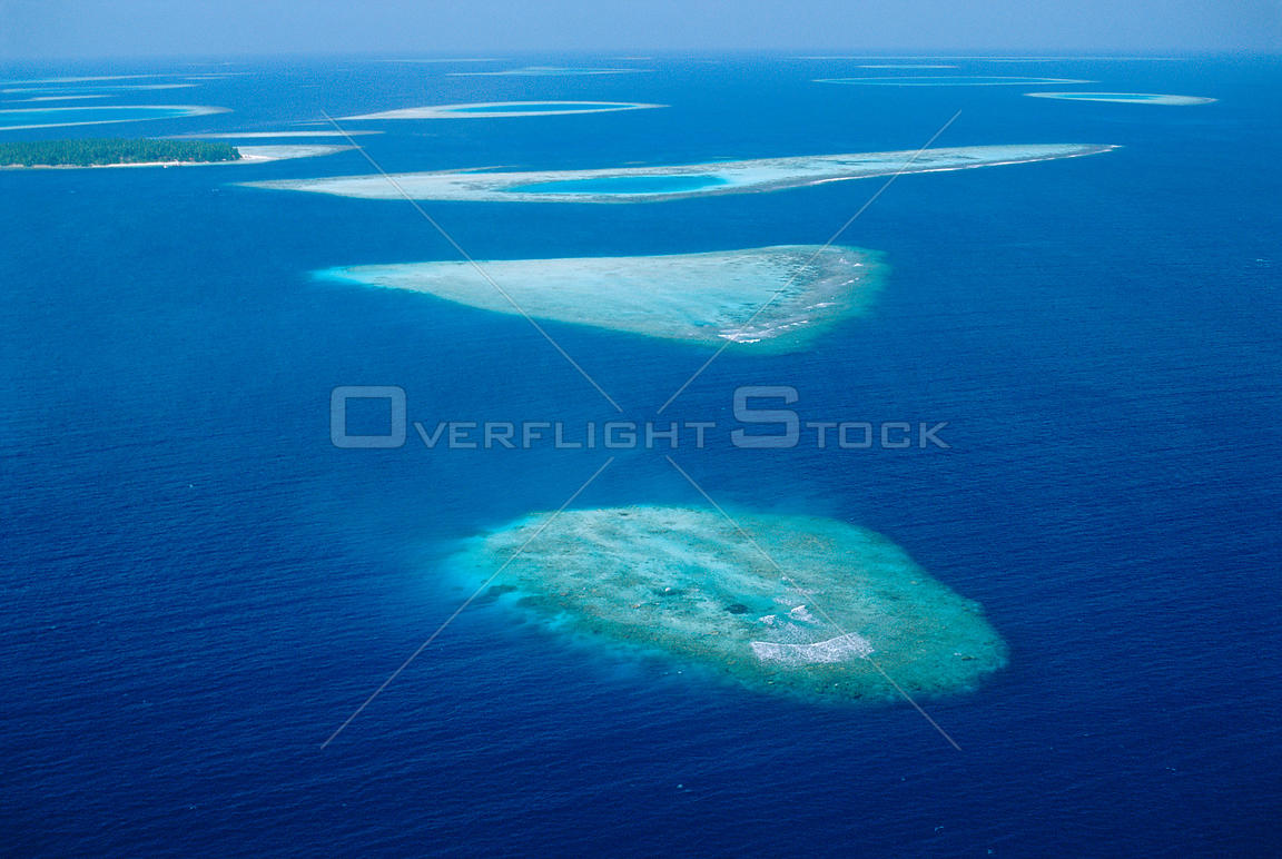 Coral atolls from the air, South Male Atoll, Maldives.