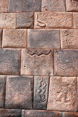Snakes carved in Inca stonework of the Nazarenas Palace, Cusco, Peru