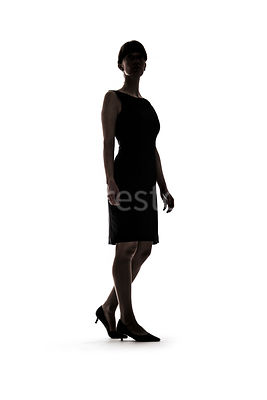 A woman, standing, or walking, in silhouette – shot from low level.