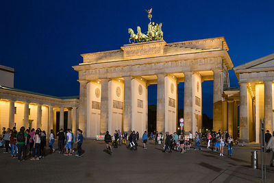 Tourists flock around The Brandenburg Gate (Brandenburger Tor) at dusk
