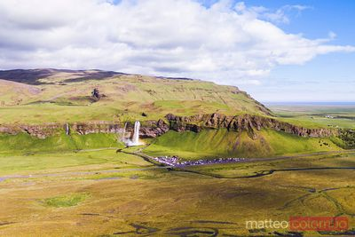 Aerial drone view of Seljalandsfoss waterfall at daytime, Iceland