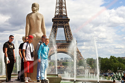 Young Men Watching with The Eiffel Tower Behind