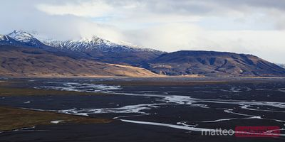 Landscape with river and mountain range at sunset Iceland
