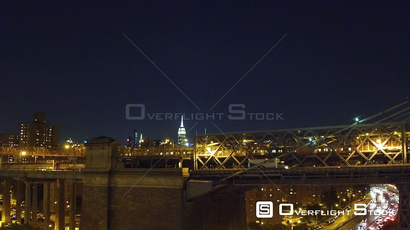 Crisp, cold night rising shot from the south side of the Williamsburg Bride facing north with views of the Empire State and C...