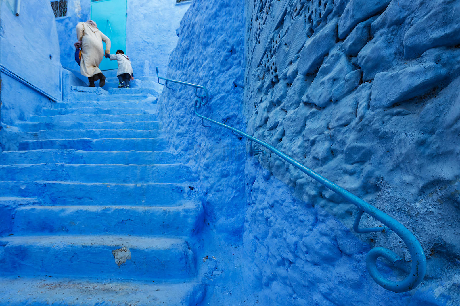 Mother and Child Walking up Steps in the Blue City