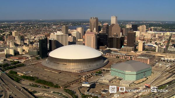 Flying past Superdome to downtown New Orleans and river view.