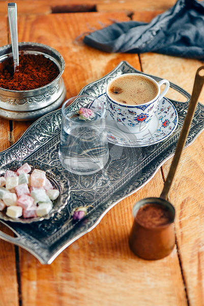 Turkish coffee served in a traditional Turkish coffee cup in a copper tray.
