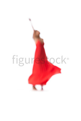 A blurred dancing woman in a red dress – shot from mid level.