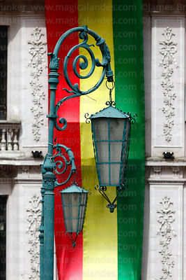 Old fashioned street lamps and Bolivian flag, Plaza San Francisco, La Paz, Bolivia