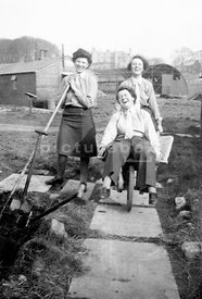 An old family photograph of some land girls having fun.