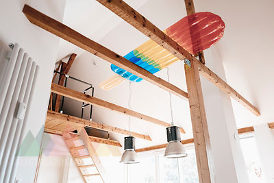 Ice lolly shaped airbed lying on roof beams