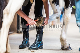 cleaning out horse hoof