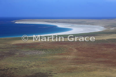 Sandy Bay, Bleaker Island from the air - a typical Falkland Islands landscape with dwarf shrub heath in the foreground and a ...